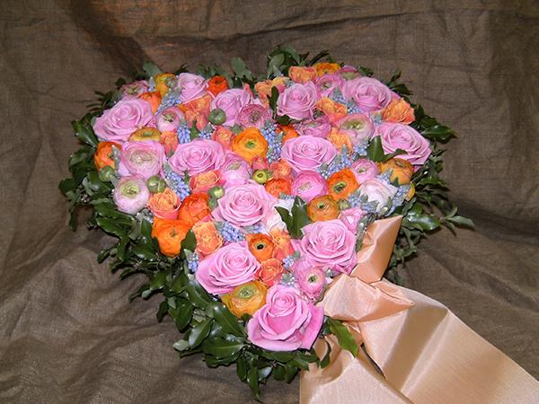vad skriver man på blommor till begravning